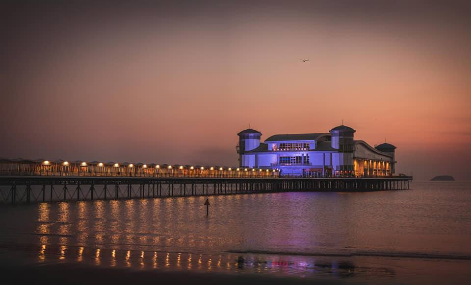 Weston super Mare Grand Pier at dusk BS23 3AT NHS Blue April 2020